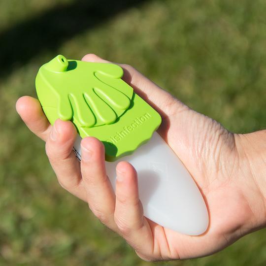 Dispensador Verde na mão